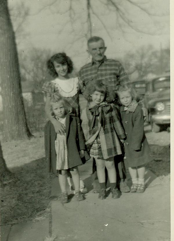 Photo labeled on back: Dec.1950, John Dighero, Bobbie, Linda, Louise, Judy.  Click for full sized view.