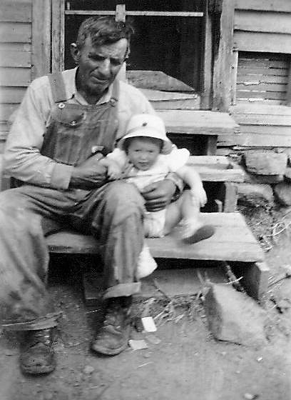 Grandpa John and Unidentified baby.  Click for full-sized view.